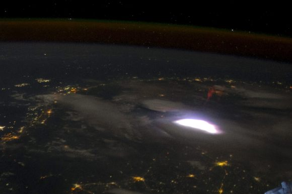 Air glow (along with a lightning sprite) is visible in this image from the International Space Station. Credit: NASA