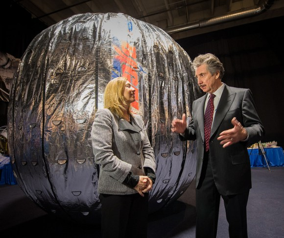 NASA Deputy Administrator Lori Garver and President and founder of Bigelow Aerospace Robert Bigelow talk while standing next to the Bigelow Expandable Activity Module (BEAM) during a media briefing on , Jan. 16, 2013. BEAM is scheduled to arrive at the space station in 2015 for a two-year technology demonstration. Photo Credit: (NASA/Bill Ingalls)