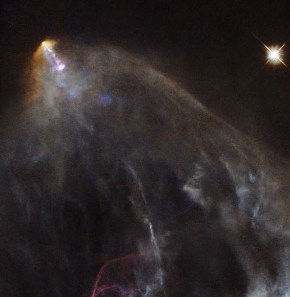 A young star is spotted firing jets of material out into space (ESA/Hubble & NASA. Acknowledgement: Gilles Chapdelaine)