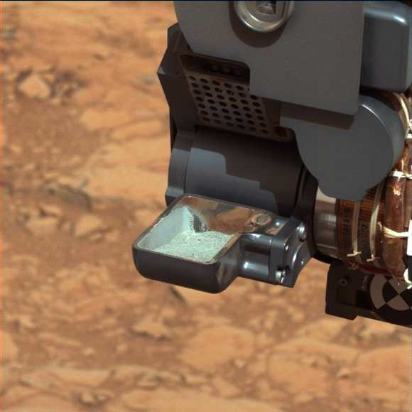 First Curiosity Drilling Sample in the Scoop. This image shows the first sample of powdered rock extracted by the rover's drill after transfer from the drill to the rover's scoop. The sample will now be sieved and portions delivered to the Chemistry and Mineralogy instrument and the Sample Analysis at Mars instrument. The scoop is 1.8 inches (4.5 centimeters) wide. The image was taken by Curiosity's Mastcam 34 camera on Feb. 20, or Sol 193.The image has been white-balanced to show what the sample would look like if it were on Earth. Credit: NASA/JPL-Caltech/MSSS