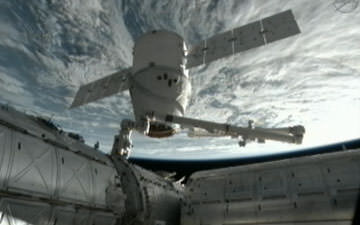 SpaceX Dragon capsule grappled by ISS robotic arm prior to today's  departure and  return to Earth and Pacific Ocean splashdown. Credit: NASA
