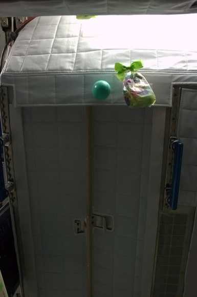 This sleep pod apparently makes for a great hiding spot for Easter eggs and gift baskets on the ISS. Credit: NASA