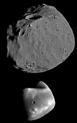 Phobos (above) and Diemos (bottom) closeup; no Martian construction projects noted. (Credit: NASA).