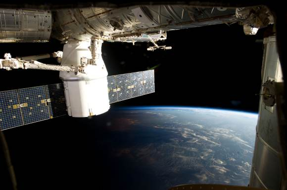 Dragon attached to the International Space Station during the CRS-2 mission. Credit: NASA.