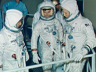 "The Apollo 1 crew training at North American's Downey Facility. Note the flags aren't on the spacesuits in this shot. Left to right: Virgil ""Gus"" Grissom Roger Chaffee, Edward White. Credit: NASA"