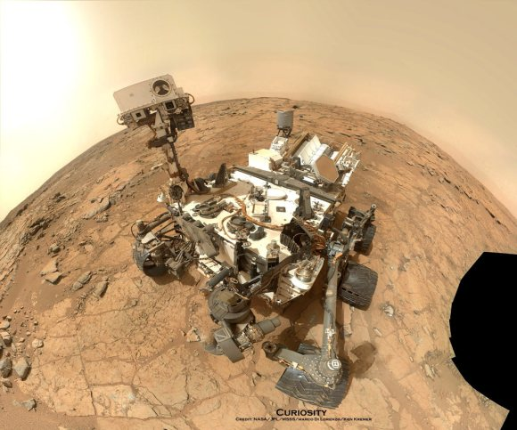 "Curiosity Rover snapped this self portrait mosaic with the MAHLI camera while sitting on flat sedimentary rocks at the ""John Klein"" outcrop where the robot conducted historic first sample drilling inside the Yellowknife Bay basin, on Feb. 8 (Sol 182) at lower left in front of rover. The photo mosaic was stitched from raw images snapped on Sol 177, or Feb 3, 2013, by the robotic arm camera - accounting for foreground camera distortion. Credit: NASA/JPL-Caltech/MSSS/Marco Di Lorenzo/KenKremer (kenkremer.com)."