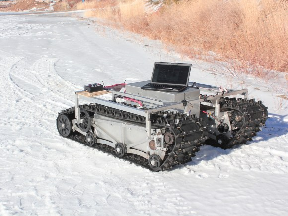 A prototype of GROVER during testing in January 2012. The rover does not have its solar panels attached here. The laptop was used as part of that specific test only. Credit: Gabriel Trisca, Boise State University