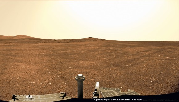 Opportunity captures a panoramic view of the road ahead to the raised rim of Solander Point (at left) which is some 0.8 mile (1.3 km) away. Arrival is targeted for August.  It features a thick strata of ancient rocks which may harbor clay minerals indicative of a habitable zone and northerly tilted slopes to maximize power generation from the solar panels during upcoming 6th winter season at Endeavour crater rim.   This navcam photo mosaic was taken on Sol 3330, June 6, 2013.   Credit: NASA/JPL/Cornell//Marco Di Lorenzo/Ken Kremer (kenkremer.com)