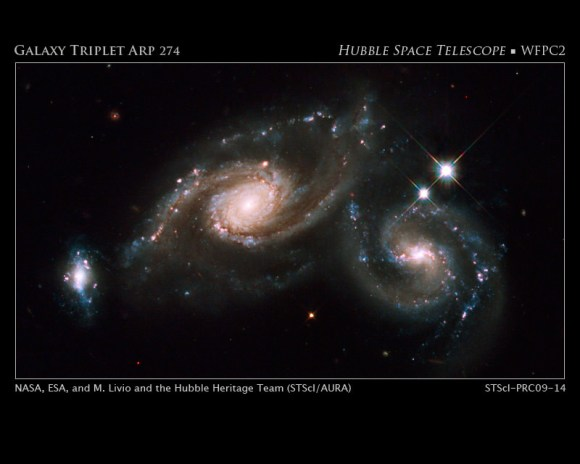 Arp 274 is a trio of galaxies. They appear to be partially overlapping in this image, but may be located at different distances. Credit: NASA, ESA, M. Livio and the Hubble Heritage Team (STScI/AURA)