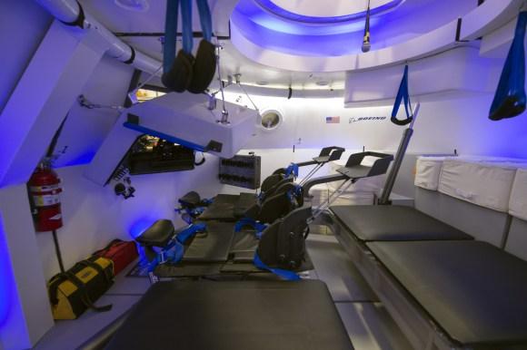 This is an interior view of The Boeing Company's CST-100 spacecraft, which features LED lighting and tablet technology.  Image Credit: NASA/Robert Markowitz