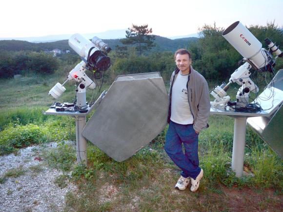 Gennady Borisov, who lives in Naunchniy near the Crimean Observatory in the Ukraine, discovered the comet C/2013 N4 on July 8. He's shown here with his two telescopes. Credit: Oleg Bruzgalov