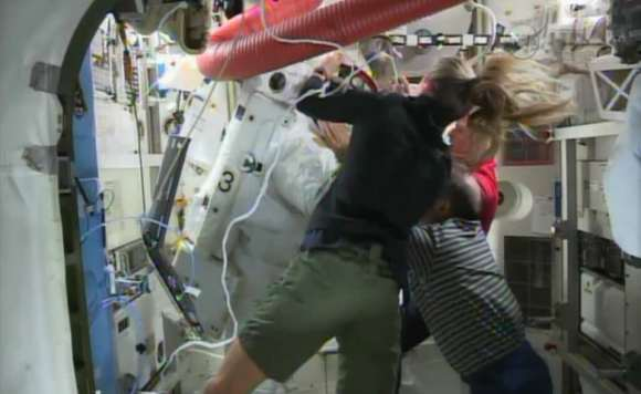 ISS Astronauts had to scramble to get Luca Parmitano out of his spacesuit after water leaked inside the suit, covering his face. Via NASA TV.