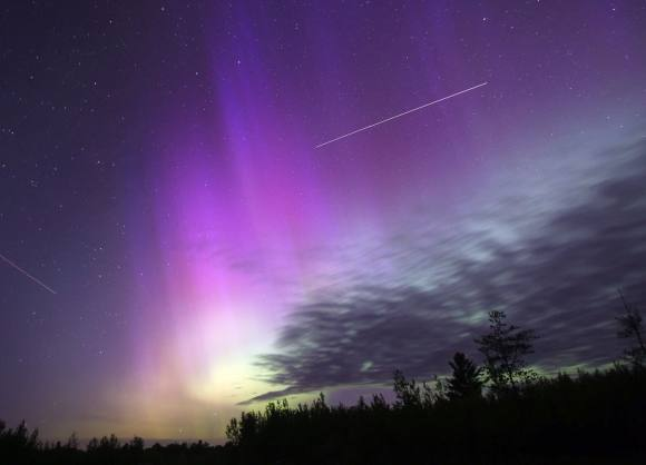 A beautiful display of the aurora borealis on June 6 this year. The line of light is the International Space Station; an airplane is off to the left. Credit: Bob King