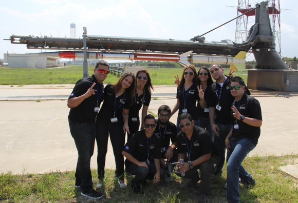 Rocket science university students from Puerto Rico pose for photo op with the Terrier-Improved Malemute sounding rocket that will launch their own developed RockSat-X science experiments to space on Aug. 13 at 6 a.m. from NASA Wallops Flight Facility, VA.  Credit: Ken Kremer/kenkremer.com