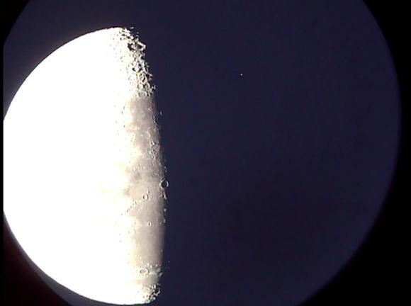 An occultation of the star Mu Geminorum (to the upper right off the dark limb of the Moon) Photo by author.