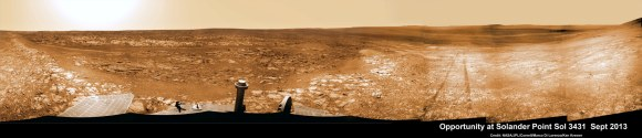 Opportunity starts scaling Solander Point - her 1st mountain climbing goal. See the tilted terrain and rover tracks in this panoramic view from Solander Point peering across the vast expanse of huge Endeavour Crater.  Opportunity will ascend the mountain looking for clues indicative of a Martian