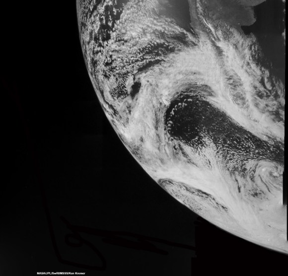 Juno swoops over Argentina  This reconstructed day side image of Earth is one of the 1st snapshots transmitted back home by NASA's Jupiter-bound Juno spacecraft during its speed boosting flyby on Oct. 9, 2013. It was taken by the probes Junocam imager and methane filter at 12:06:30 PDT and an exposure time of 3.2 milliseconds. Juno was flying over South America and the southern Atlantic Ocean. The coastline of Argentina is visible at top right. Credit: NASA/JPL/SwRI/MSSS/Ken Kremer