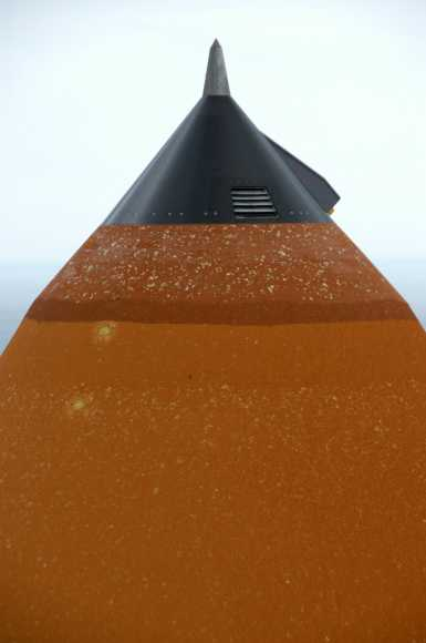 Hail damage is visible on the external tank attached to Space Shuttle Atlantis on the launchpad during a strong thunderstorm that passed through Kennedy Space Center on Feb. 26, 2007. Credit: NASA/KSC.