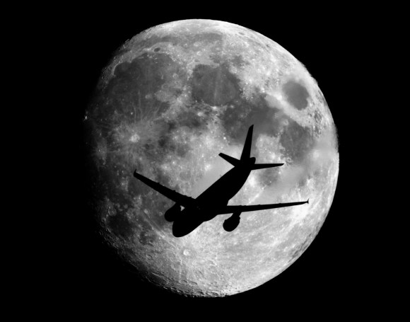 An airplane at about 2,400 meters above the ground  passes in front of the Moon on its way to landing at the Charles de Gaulle Airport in Paris, France. Taken from about 70 km from Paris. Credit and copyright: Sebastien Lebrigand.