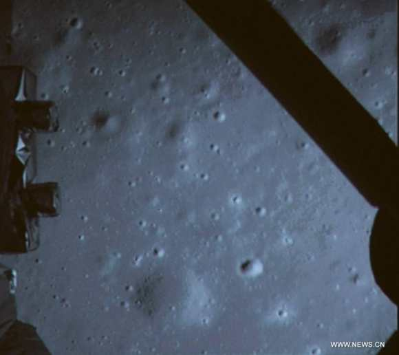 Photo taken on Dec. 14, 2013 shows a picture of the moon surface taken by the on-board camera of lunar probe Chang'e-3 on the screen of the Beijing Aerospace Control Center in Beijing.   This marks the first time that China has sent a spacecraft to soft land on the surface of an extraterrestrial body.  Credit: Xinhua/CCTV