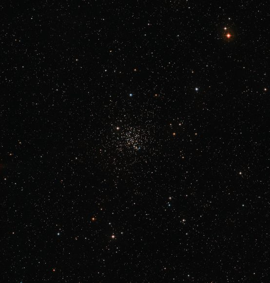 This wide-field image of the sky around the old open star cluster Messier 67 was created from images forming part