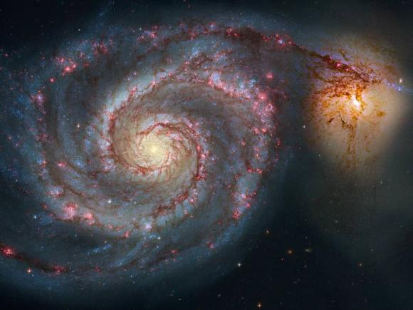 The 51st entry in Charles Messier's famous catalog is perhaps the original spiral nebula--a large galaxy with a well defined spiral structure also cataloged as NGC 5194. Over 60,000 light-years across, M51's spiral arms and dust lanes clearly sweep in front of its companion galaxy, NGC 5195. Image data from the Hubble's Advanced Camera for Surveys was reprocessed to produce this alternative portrait of the well-known interacting galaxy pair. The processing sharpened details and enhanced color and contrast in otherwise faint areas, bringing out dust lanes and extended streams that cross the small companion, along with features in the surroundings and core of M51 itself. The pair are about 31 million light-years distant. Not far on the sky from the handle of the Big Dipper, they officially lie within the boundaries of the small constellation Canes Venatici. Image Credit: NASA
