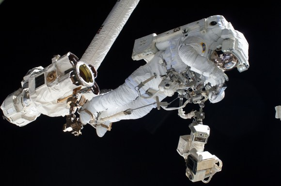 European Space Agency astronaut Luca Parmitano on a spacewalk July 9, 2013 during Expedition 36. Here, Parmitano is riding the end of the robotic Canadarm2. Credit: NASA
