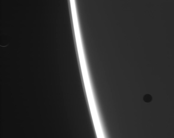 Raw image of Saturn with two moons acquired by Cassini on March 11, 2014 (NASA/JPL-Caltech/SSI)