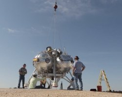 Engineers prepare the Morpheus craft for its FF9 test flight on March 11, 2014 (NASA)