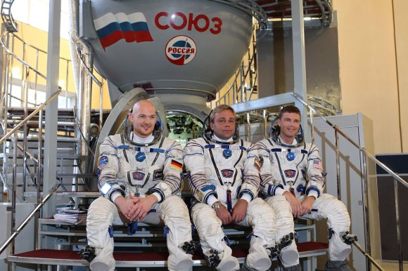 The crew members of Expedition 40/41 pose in front of a Soyuz spacecraft simulator in Star City, Russia. From left, Alex Gerst (European Space Agency), Max Suraev (Roscosmos) and Reid Wiseman (NASA). Credit: NASA