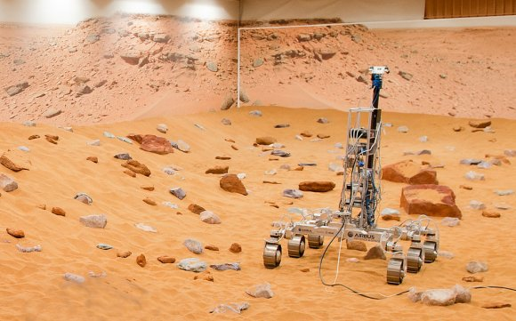 "A Martian rover prototype nicknamed ""Bryan"" inside a newly upgraded ""Mars Yard"" in Stevenage, United Kingdom. The European Space Agency announced the improvements as it works on the ExoMars rover, which is slated to land on the Red Planet in 2018. Credit: Airbus Defence and Space"