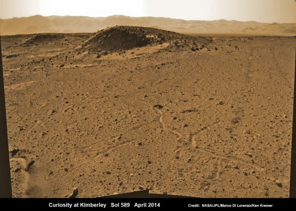 Curiosity maneuvers into 'Kimbeley' and scans scientifically intriguing Martian rock outcrops in search of next drilling location exhibiting several shallow hills.  Rover tracks at right in this colorized Navcam photomosaic assembled from raw images snapped on Sol 589, April 3, 2014. Credit: NASA/JPL/Marco Di Lorenzo /Ken Kremer - kenkremer.com