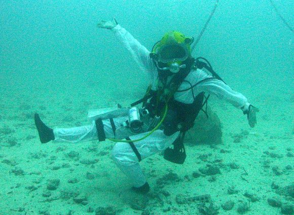 NEEMO 15's Shannon Walker (NASA astronaut) does a little dance during a simulated asteroid mission. Credit: NASA