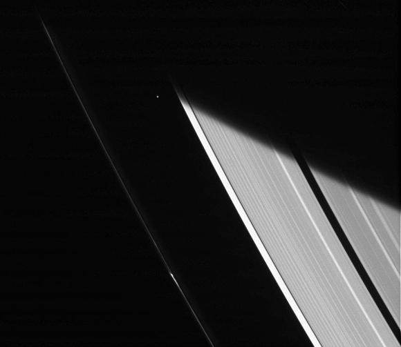 Saturn's moon Atlas peeks out between the rings in this Cassini shot taken Jan. 23, 2014. Credit: NASA/JPL-Caltech/Space Science Institute