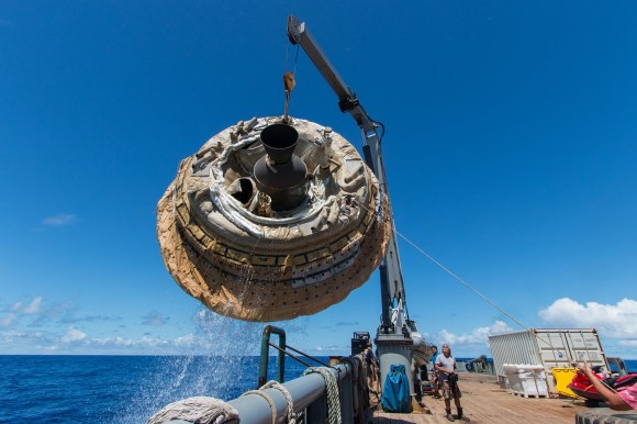 A recovery vessel lifts the Low-Density Supersonic Decelerator aboard after its June 28, 2014 test over the U.S. Navy's Pacific Missile Range. Credit: NASA/JPL-Caltech