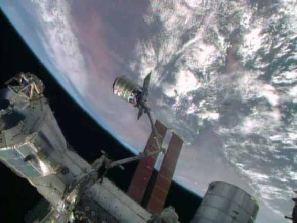 The International Space Station's robotic arm, Canadarm2, grapples the Orbital Sciences' Cygnus cargo craft on July 16, 2014. Image Credit: NASA TV