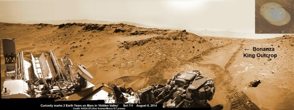 NASA's Curiosity rover looks back to ramp with 4th drill site target at 'Bonanza King' rock outcrop in 'Hidden Valley' in this photo mosaic view captured on Aug. 6, 2014, Sol 711.  Inset shows results of brushing on Aug. 17, Sol 722 that revealed gray patch beneath red dust.  Note the rover's partial selfie, valley walls, deep wheel tracks in the sand dunes and distant rim of Gale crater beyond the ramp. Navcam camera raw images stitched and colorized.  Credit: NASA/JPL-Caltech/Ken Kremer-kenkremer.com/Marco Di Lorenzo