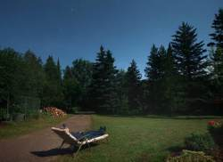 "The author tries his best to enjoys this year's moon-drenched Perseids from the ""astro recliner"". Credit: Bob King"