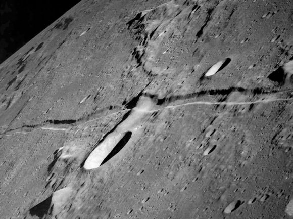 Rima Ariadaeus as photographed from Apollo 10. The crater to the south of the rille in the left half of the image is Silberschlag. The dark patch at the top right is the floor of the crater Boscovich. Credit: NASA
