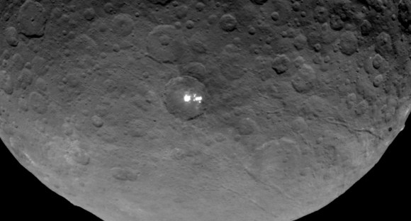 In this uncropped single frame, not only are multiple white spots visible but also long, parallel cracks or troughs in Ceres' surface. Credit: