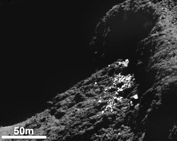 Example of a cluster of bright spots on Comet 67P/Churyumov-Gerasimenko found in the Khepry region. The bright patches are thought to be exposures of water-ice. Credit: ESA/Rosetta/MPS for OSIRIS Team MPS/UPD/LAM/IAA/SSO/INTA/UPM/DASP/IDA