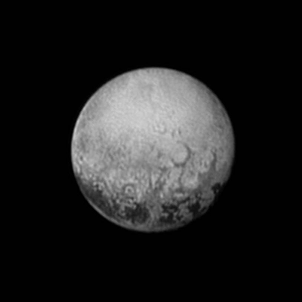 New Horizons' last look at Pluto's Charon-facing hemisphere reveals the highest resolution view of four intriguing darks spots for decades to come.  This image, taken early the morning of July 11, 2015, shows newly-resolved linear features above the equatorial region that intersect, suggestive of polygonal shapes. This image was captured when the spacecraft was 2.5 million miles (4 million kilometers) from Pluto.  Credit: NASA/JHUAPL/SWRI