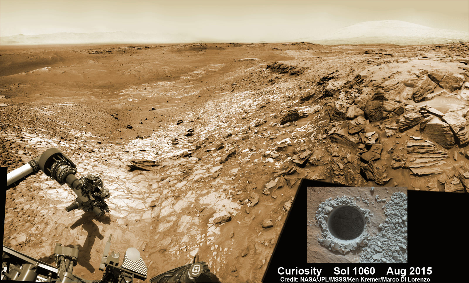 "Curiosity extends robotic arm and conducts sample drilling at ""Buckskin"" rock target at bright toned ""Lion"" outcrop at the base of Mount Sharp on Mars, seen at right.   Gale Crater eroded rim seen in the distant background at left, in this composite multisol mosaic of navcam raw images taken to Sol 1059, July 30, 2015.  Navcam camera raw images stitched and colorized. Inset: MAHLI color camera up close image of full depth drill hole at ""Buckskin"" rock target on Sol 1060.  Credit:  NASA/JPL-Caltech/MSSS/Ken Kremer/kenkremer.com/Marco Di Lorenzo"