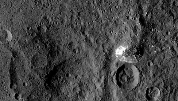 NASA's Dawn spacecraft spotted this tall, conical mountain on Ceres from a distance of 915 miles (1,470 kilometers). The mountain, located in the southern hemisphere, stands 4 miles (6 kilometers) high. Its perimeter is sharply defined, with almost no accumulated debris at the base of the brightly streaked slope. The image was taken on August 19, 2015.Credit: NASA/JPL-Caltech/UCLA/MPS/DLR/IDA