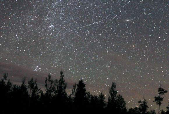 A Perseid meteor streaks across the northeastern sky two Augusts ago. This year's shower will peak on the night of August 12-13 with up to 100 meteors per hour visible from a dark sky. Credit: Bob King