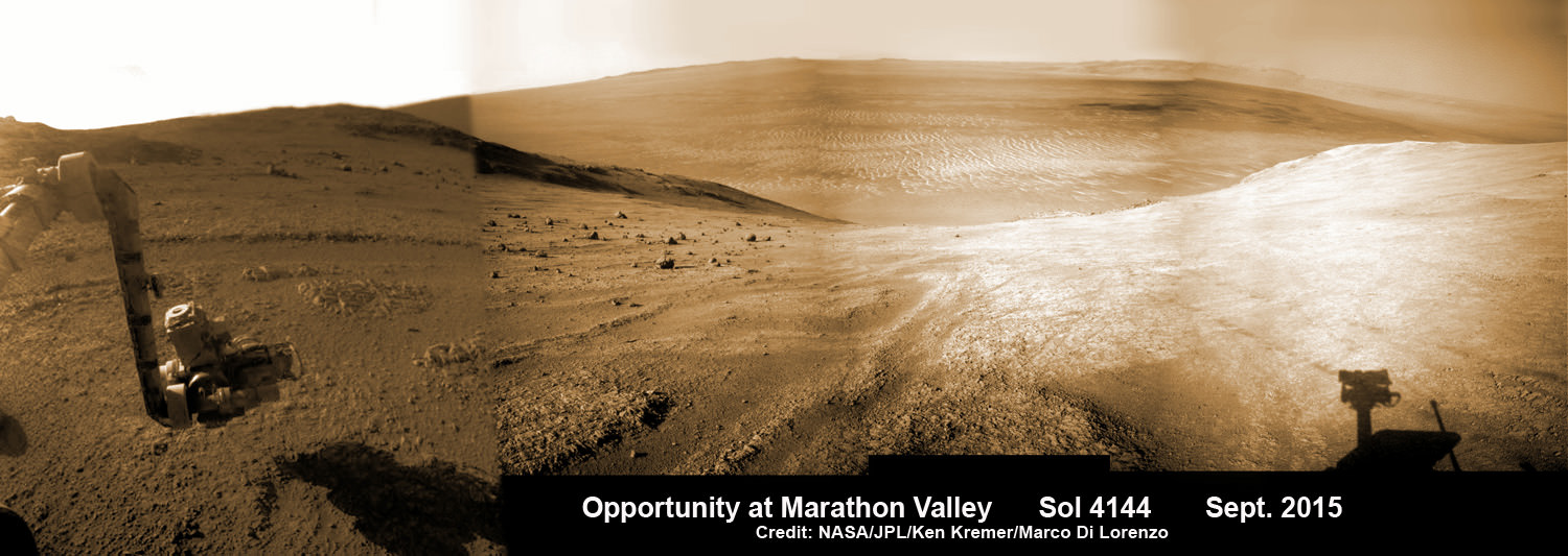 Panoramic view from NASA's Opportunity rover looking down the floor of Marathon Valley and out to the vast expense of Endeavour Crater. Marathon Valley holds significant deposits of water altered clay minerals.  This composite photo mosaic shows the rover's robotic arm reaching out at left to investigate Martian rocks holding clues to the planets watery past, and robot shadow and wheel tracks visible at right. The mosaic combines a flattened fisheye hazcam image at left with a trio of navcam camera images taken on Sol 4144 (Sept. 20, 2015) and colorized.  Credit: NASA/JPL/Cornell/Ken Kremer/kenkremer.com/Marco Di Lorenzo