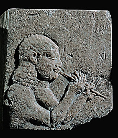 A flute player. Detail from a stone bas-relief (7th BCE) from the palace of Ashurbanipal in Niniveh, Mesopotamia (Iraq).