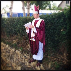 Rehearsing ahead of the ceremony. The Cardinal outfit was just for fun!