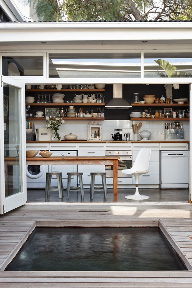 Indoor outdoor kitchen with plunge pool in Australia.