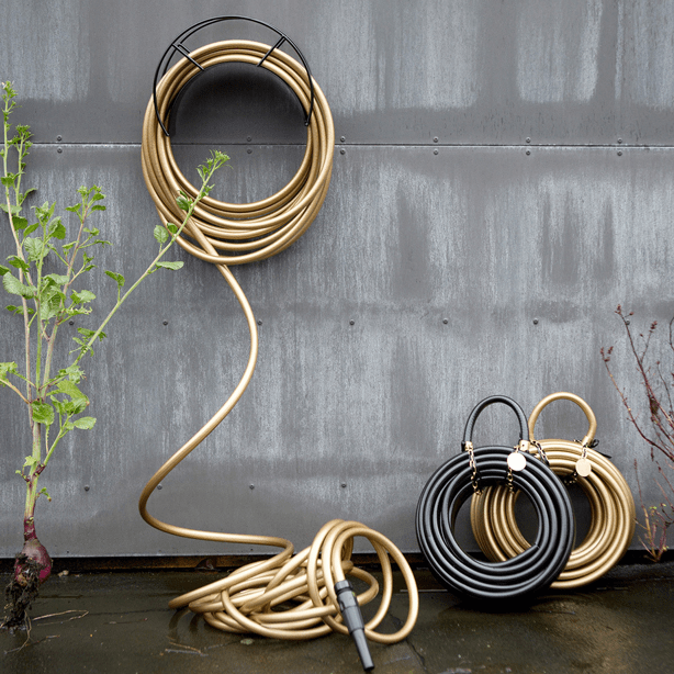garden-glory-gold-hose-on-concrete-wall